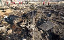 Rescue teams work at the scene after a Ukrainian plane carrying 176 passengers crashed near Imam Khomeini airport in the Iranian capital Tehran early in the morning on 8 January 2020, killing everyone on board. Picture: AFP