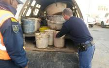 Police and soldiers descended in Manenberg during their Operation Fiela to search for illegal goods, weapons and drugs on 21 May 2015. Picture:@SAPoliceService