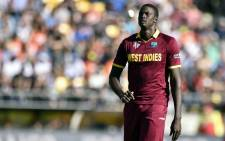 West Indies' captain Jason Holder walks back to bowl during the Cricket World Cup quarter-final match between New Zealand and the West Indies in Wellington on 21 March, 2015. Picture: AFP
