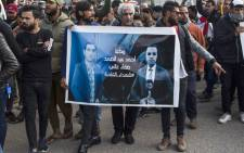 Iraqis take part in a rally on 11 January 2020, to mourn two reporters (image) shot dead the previous evening in the country's southern city of Basra. Picture: AFP