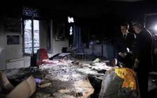 "President Emmanuel Macron inspects damage after ""yellow vest"" protest. Picture: @EmmanuelMacron/Twitter."