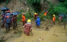 Bangladeshi firefighters search for bodies after a landslide in Bandarban on June 13, 2017. Picture: AFP
