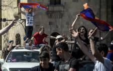 Protestors shout slogans and wave flags as they demonstrate in Yerevan on 2 May 2018, as popular anger exploded over the ruling party's rejection of opposition leader's premiership bid. Picture: AFP