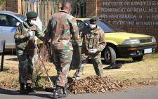 Members of the South African Defence Forces clean up Chris Hani Baragwanath Hospital in Soweto on Mandela Day. Picture: Taurai Maduna/EWN