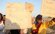Women gather to protest on 17 August, 2012 against the police shooting which claimed the lives of 28 miners and injured 78 others at the Lonmin's Marikana mine on 16 August 2012. Picture: Taurai Maduna/Eyewitness News.
