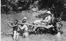 This undated file picture taken in Senegal shows a European traveller being carried through a river by African porters. Picture: AFP.