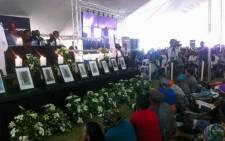 Families and friends of the Harmony Gold miners who died underground last week attend a memorial service, 12 February 2014. Picture: Lesego Ngobeni/EWN.