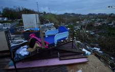 Debris is scattered around a destroyed house in the Acerolas neighbourhood, in Toa Alta, Puerto Rico, on 1 October, 2017. Picture: AFP.