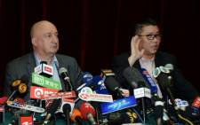 Malaysian Airlines senior officials Dr Hugh Dunleavy (L) and member of the airline's crisis management team, Ignatius Ong (R), face the Chinese media after arriving in China to deal with the missing Malaysia Airlines Boeing 777-200 plane, in Beijing on 8 March 2014. Picture: AFP.