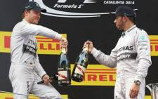 Mercedes drivers Lewis Hamilton and Nico Rosberg celebrating on the podium at the Spanish Grand Prix. Picture: Facebook.