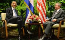 FILE: US President Barack Obama (L) and Cuban President Raul Castro meet at the Revolution Palace in Havana for groundbreaking talks on ending the standoff between the two neighbors on 21 March 2016. Picture: NICHOLAS KAMM/AFP.