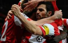 Arsenal's Spanish midfielder Cesc Fabregas celebrates a goal during the team's Champions League match against Barcelona on 16/02/11. Picture: AFP.
