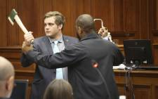 Triple murder accused Henri van Breda demonstrates how he allegedly fought off the masked intruder attacked his family in January 2015. Picture: Cindy Archillies/EWN