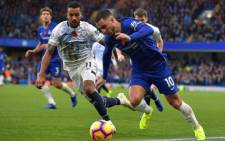 Chelsea's Belgian midfielder Eden Hazard (R) vies with Everton's English striker Theo Walcott (L) during the English Premier League football match between Chelsea and Everton at Stamford Bridge in London on 11 November 2018. Picture: AFP