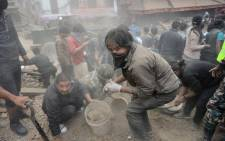 People clear rubble in Kathmandu's Durbar Square, a UNESCO World Heritage Site that was severely damaged by an earthquake on 25 April, 2015. Picture: AFP