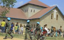 Malawian peacekeepers of The United Nations Organization Stabilization Mission in the Democratic Republic of the Congo (MONUSCO) stand guard outside the Emmanuel Butsili Catholic church in Beni, on 27 June 2021, after a makeshift bomb exploded, injuring two just an hour before a children's Confirmation ceremony was due to be held. Picture: Sébastien KITSA MUSAYI/AFP