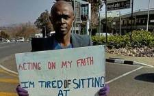 Ndumiso Sikhakhane, who stood with a board at a busy intersection in Sandton, has landed a new job. Picture: Supplied.