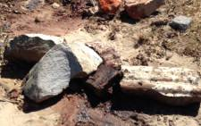 FILE: Bloodied stones on the scene where six male bodies were found dumped on 10 December 2014. Picture: Lauren Isaacs/EWN.