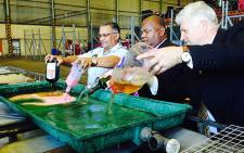 Western Cape authorities pour down the drain alcohol which was confiscated from illegal outlets. Picture: Rafiq Wagiet/EWN