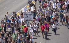 Protesters march down Somerset Road towards Cape Town Stadium in support of the Zuma Must Fall movement on 16 December 2015. Picture: Aletta Harrison/EWN