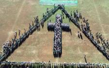 Pupils at Schoonspruit Secondary School formed a cross while praying for those affected by the Hoërskool Driehoek tragedy in Vanderbijlpark. Picture: Sanette Vd Merwe Brits/facebook.com.