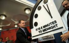 """The Bulletin of the Atomic Scientists unveil the 2018 """"Doomsday Clock"""" on 25 January, 2018 in Washington, DC. Picture: AFP"""