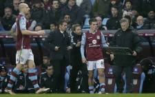 FILE: Aston Villa's French manager Remi Garde (2L) watches as Aston Villa's English midfielder Jack Grealish (2R) waits to be substituted on during the English Premier League football match between Aston Villa and Arsenal at Villa Park in Birmingham, central England on December 13, 2015. Arsenal won the match 2-1. Picture: AFP