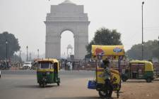"FILE: An icecream vendor waits for customers under heavy smog near India Gate in New Delhi on 28 October 2019. Air quality in the Indian capital turned ""hazardous"" on 28 October 2019 after a night of frenzied fireworks by revellers defying a Supreme Court ban to celebrate the Hindu festival of lights, Diwali. Picture: AFP"