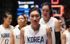 Unified Korea's Lim Yung-hui (C) leaves the court after defeat during the women's gold medal basketball match between Unified Korea and China at the 2018 Asian Games in Jakarta on 1 September, 2018. Picture: AFP