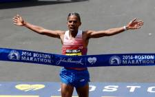 Meb Keflezighi of the United States crosses the finish line to win the 118th Boston Marathon on 21 April, 2014 in Boston, Massachusetts. Picture: AFP.