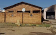 A burnt house is seen in Ikwezi township in Mthatha, Eastern Cape, where five people died. Picture: SAPS.