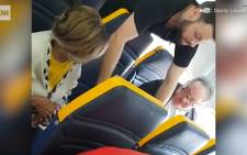 A passenger on a Ryanair flight went on a racist rant at another passenger for speaking to him in a foreign language, but he wasn't removed from the plane. CNN reports.