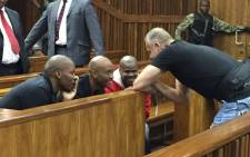 Radovan Krejcir chatting to his co-accused during an adjournment. Picture: Mandy Weiner/EWN.