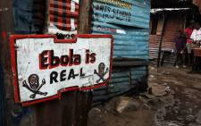 An Ebola sign placed in front of a home in the West Point slum area of Monrovia, Liberia. Picture: EPA.