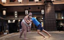Novak Djokovic pictured in the ring during a sumo match in Japan. Picture: @DjokerNole/Twitter