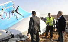 A handout picture released by Egypt's Prime Minister's office on 31 October 2015, shows PM Sherif Ismail (R) at the site of the wreckage of a crashed A321 Russian airliner in Hassana a mountainous area of Egypt's Sinai Peninsula. Picture: AFP