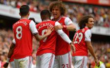 Arsenal players celebrate a goal. Picture: AFP