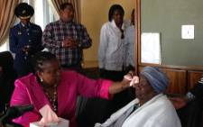 Gauteng Community Safety MEC Sizakele Nkosi-Malobane comforts Warrant officer Bophelo Mosekwana's mother, Gift, who was shot dead while patrolling in Hillbrow. Picture: Masego Rahlaga/EWN.