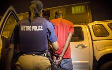 FILE: A Metro Police officer arrests a suspect in Cape Town. Picture: Thomas Holder/EWN.