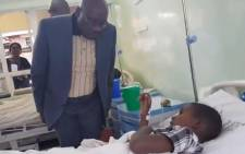 Zimbabwe's Health Minister David Parirenyatwa interacts with a patient at the Beatrice Road Infectious Diseases Hospital. Picture: @MoHCCZim/Twitter