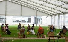 FILE: Students maintain social distancing in a large marquee erected by the university to create an additional socially distanced rest area to help mitigate the spread of the novel coronavirus COVID-19, at the University of Bolton, in Bolton, northern England on 7 October 2020. Picture: AFP