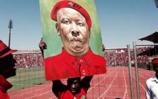 A supporter holds up a painting of EFF leader Julius Malema at a pre-election rally in Atteridgeville, Pretoria. Picture: Sebabatso Mosamo/EWN.