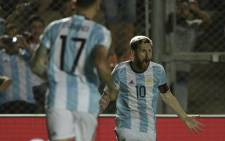 Argentina's Lionel Messi celebrates with teammates after scoring against Colombia during their 2018 Fifa World Cup qualifier football match in San Juan, Argentina, on 15 November, 2016. Picture: AFP.