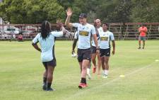 Blitzbok captain Philip Snyman high fives Branco du Preez after a productive training session in Cape Town before the HSBC Sevens World Series. Picture: Bertram Malgas