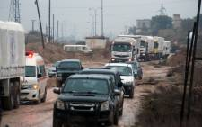 A convoy of aid vehicles drive in Syria's Idlib province as they head to the government-controlled towns of Fuaa and Kafraya to deliver aid on 11 January. 2016. Picture: AFP.