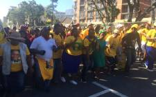 ANC members singing and dancing as march to the party 103 celebration to held at the Cape Town Stadium on 10 January 2015. Masa Kekana/EWN.