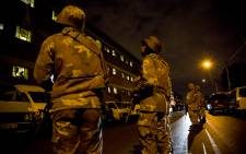FILE. Police and members from SANDF launched a massive raid at the Jeppestown hostel, searching for illegal weapons, drugs and stolen goods on 21 April 2015. Picture: Thomas Holder/EWN.