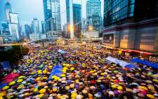 Pro-democracy protesters open their umbrellas for 87 seconds, marking the 87 rounds of tear gas that were fired by the Hong Kong police at unarmed student protesters in exactly the same location one month ago, at the Admiralty protest zone which has been newly dubbed 'Umbrella Square', Admiralty, Hong Kong, China, 28 October 2014. EPA/ALEX HOFFORD