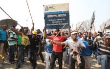 Striking Anglo Platinum workers demonstrate at the company's Blesbok stadium, demanding a R12 500 salary. Picture: Taurai Maduna/EWN.