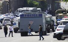 Armenian police officers block the streets to Erebuni police station in Yerevan on 17 July, 2016. An armed group with links to an imprisoned opposition leader. Picture: AFP.